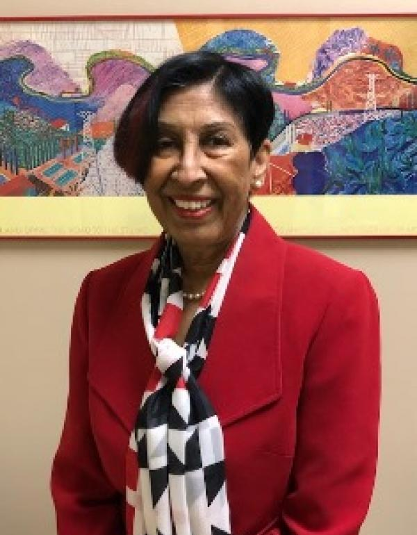 Dr.   Nasreen Roberts